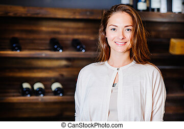A young successful woman winemaker