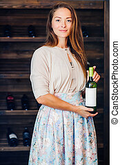 A young successful woman winemaker, businessman