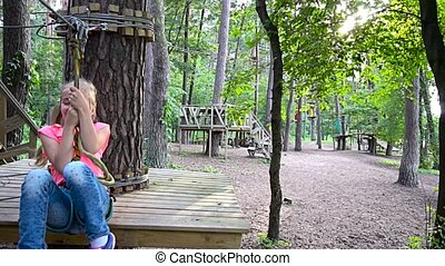 girl playing in adventures park - little girl playing in...