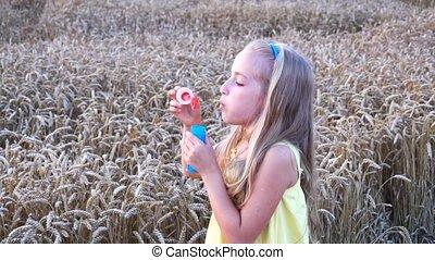 cute girl in wheat field slow motion