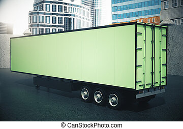 Sideview of green semi-trailer - Green semi-trailer on city...