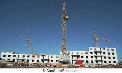 Construction site include four construction cranes