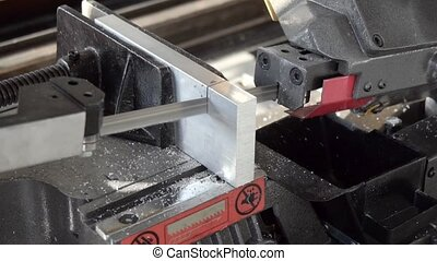 belt saw cutting metal slow motion
