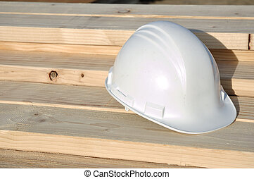 White Hard Hat on Lumber