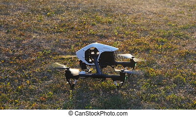 Drone takes off from the grass - This is a radio-controlled...