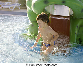 little cute real boy in swimming pool close up smiling,...