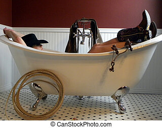 Montana Cowgirl - Cowgirl lounges in old fashioned tub
