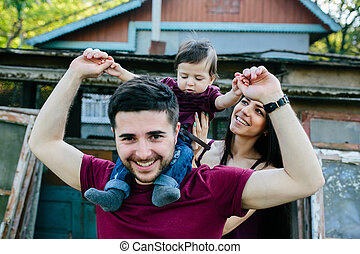 young family with a child on the nature - young family on...