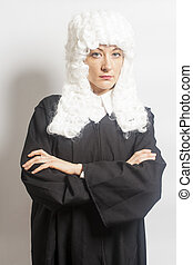 Female judge wearing a wig and Back mantle on white...