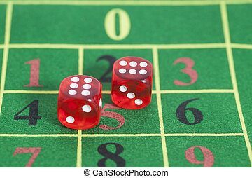 roll of the red dice on a game table in a casino