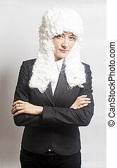 Female judge wearing a wig on white