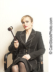 Female Judge With Wooden Gavel In Chair