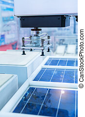production of solar panels, Industrial robot working in...