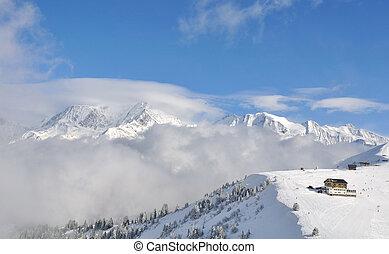 mountain landscape in winter - ski resort in snowy mountain...