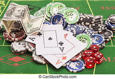 Poker chips, money,playing cards and dice