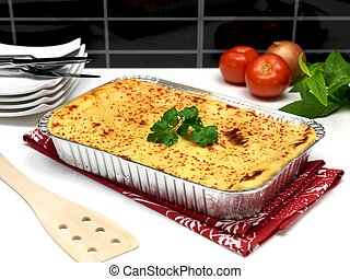 Lasagne - A tray of lasagne ready for plating