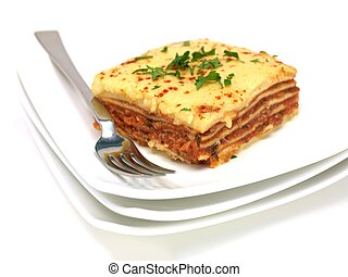 Lasagne plated up and isolated against a white background