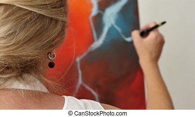 Techniques of painting - An artist is showing some...