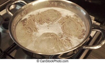 Noodles boiling in a pan