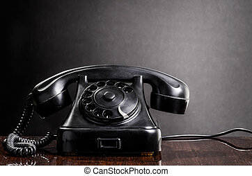 Old black telephone retro 1970s style
