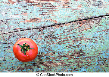 Red Tomato on Old Rustic Table Top
