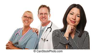 Hispanic Woman with Male Doctor and Nurse