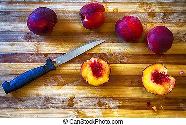Cut peach over chopping board