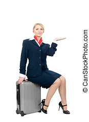 a stewardess holding something - a pretty stewardess sitting...