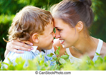 I love you - Portrait of handsome boy and his mother having...