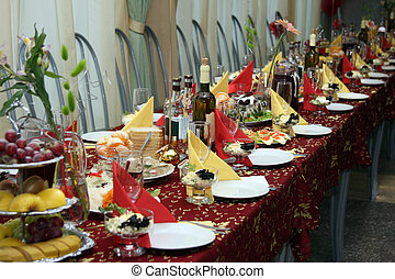 The table covered by a holiday with drinks and various...