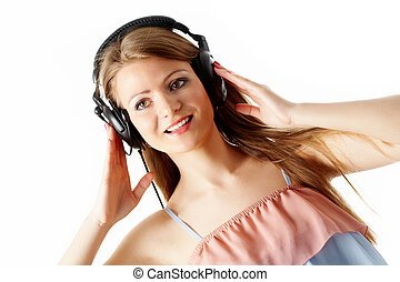 At leisure - Close-up of pretty girl touching headphones and...
