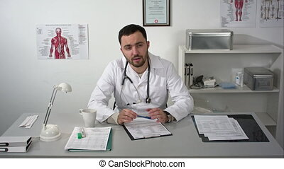 Doctor seriously explaining to camera like to patient