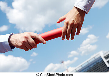 Passing baton - Photo of business people hands passing baton...