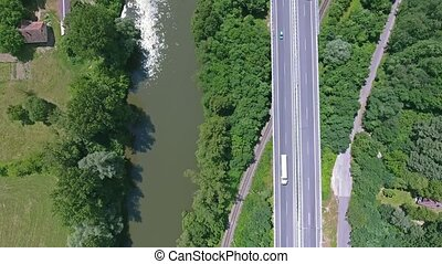 Aerial view of highway, railway, river, forest and grassland...