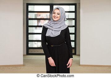 Young Muslim Woman Praying In Mosque - Young Muslim Woman...