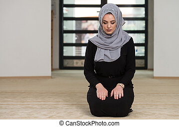 Young Woman Praying In The Mosque - Young Muslim Woman...