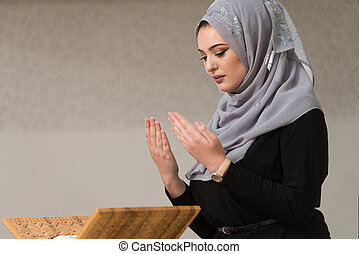 Young Woman Reading The Koran At The Mosque - Muslim Woman...