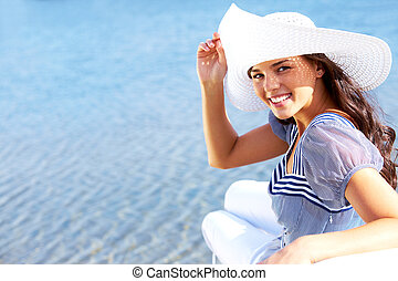 Vacation mood - Portrait of pretty young lady in hat...