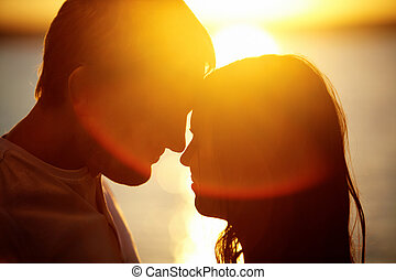 Closeness - Profiles of romantic couple looking at each...