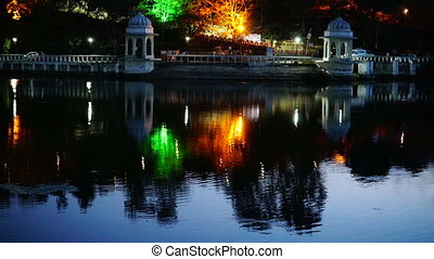 Architecture and reflection in lake. - Night illuminated...