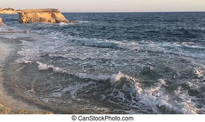 choppy sea near a rock islet - Choppy sea near a rock islet...