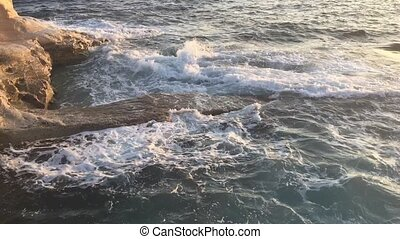 Sea waves at cliff foot - sea waves breaking at the foot of...