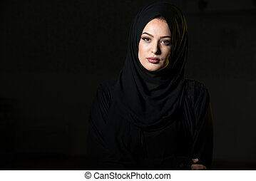 Attractive Muslim Woman On Black Background - Portrait Of A...