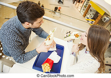 Couple having fun in fast food restaurant