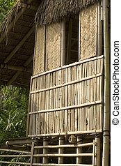 Bamboo house - Traditional Asian house set up high on stilts