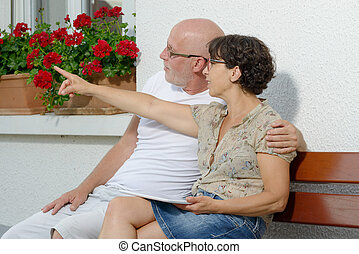 senior couple with a tablet, outdoor - a senior couple with...