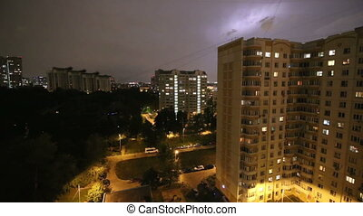 Thunderstorm flashes and lightning over the city, in night...