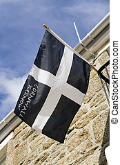 Cornwall flag - The banner of Saint Piran hangs outside a...