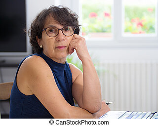 portrait of a beautiful mature woman with glasses