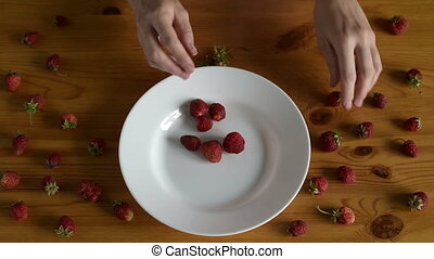 Preparing strawberries for making jam - Female hands...